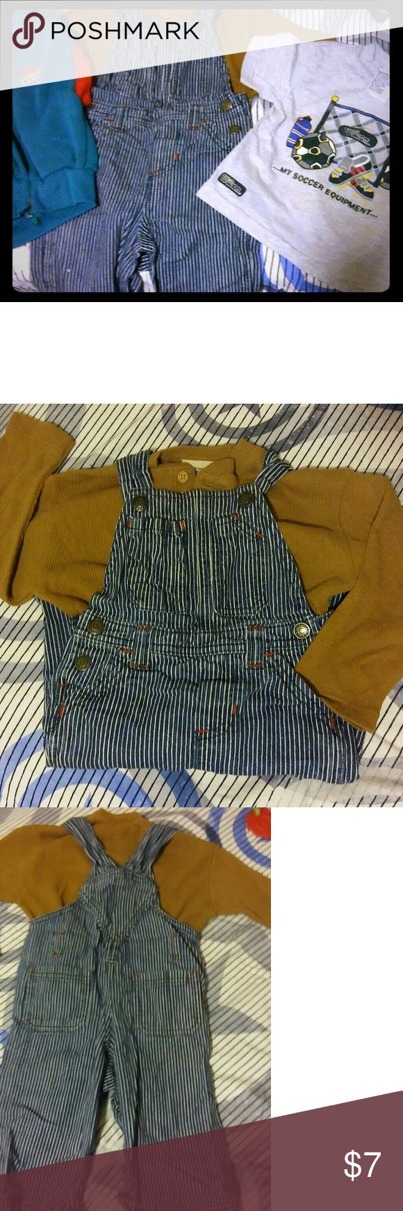 Overalls with 2 shirts and a vest Adorable Old Navy stripped overalls size 12-18 month.  Brown long sleeve shirt, wilson sports themed t-shirt and a cute hooded vest with a firetruck on it thrown in a bundle. Old Navy Bottoms Overalls