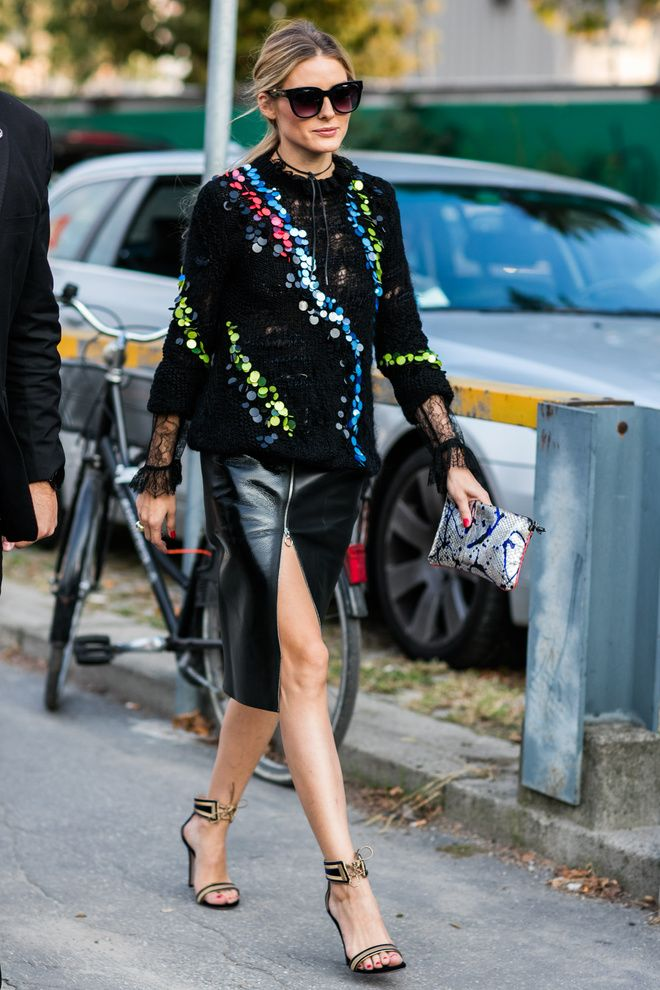 Olivia paired a sequined sweater with a slit leather skirt