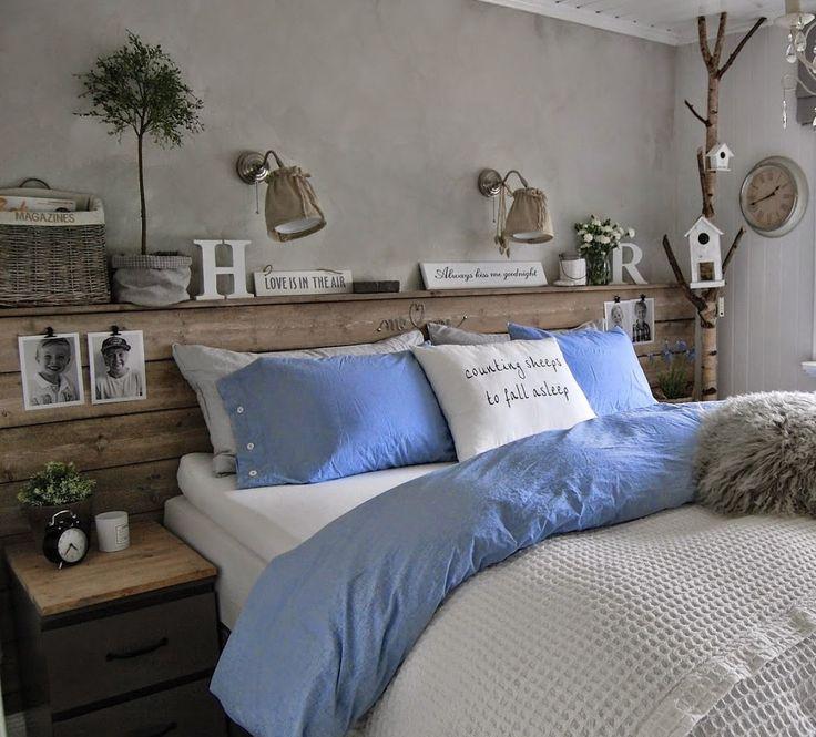 Urgemütliches Schlafzimmer mit selbst gemachtem Kopfteil aus Brettern fürs Bett