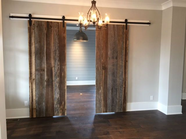 Reclaimed barn wood doors repurposed as, well, barn wood doors.