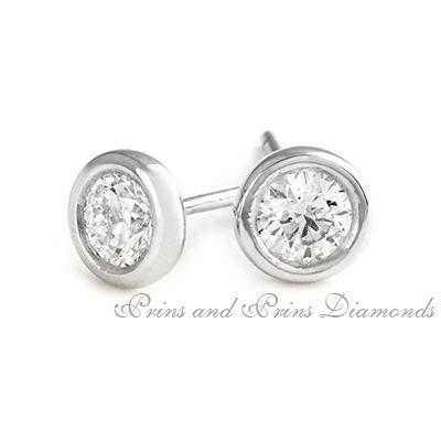 2 = 0.35ct GH/VS – SI round brilliant cut diamonds set in 18k white gold
