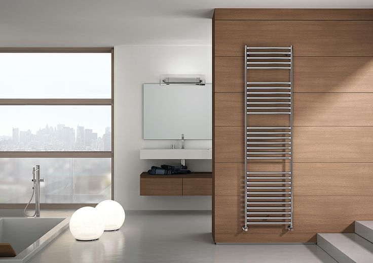 STILÉ: scaldasalviette in Acciaio Inox Satinato. Gli abbinamenti dei materiale e delle lavorazioni lo rendono unico ed originale. // STILÉ: Stainless Steel towel warmer with satin finish. The combinations of the material and the workmanship make it.#bathroom #home #furniture #heating #casa #riscaldamento