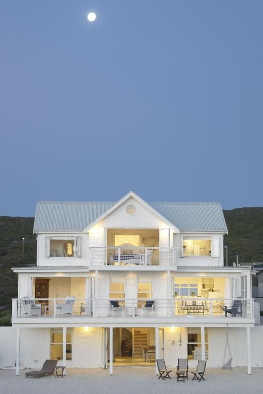 Dream home. Almost all white, on the beach. Beachside, the walls are open and glass.
