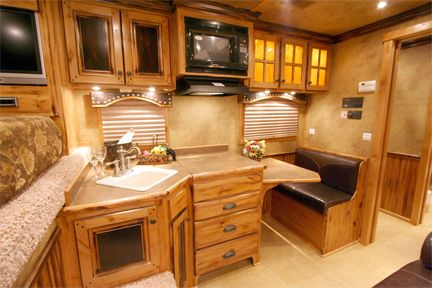 Love the small table... great little kitchen area in this LQ trailer.