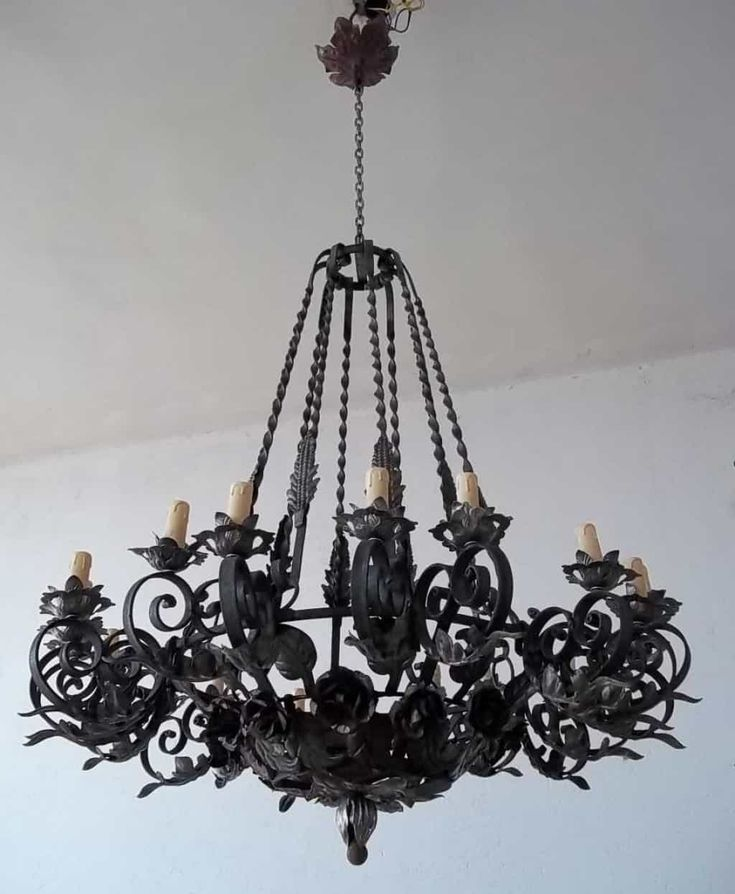 Black Vintage Wrought Iron Chandelier Hung In The White Ceiling : Majestic Wrought Iron Chandeliers Create Rustic Feel