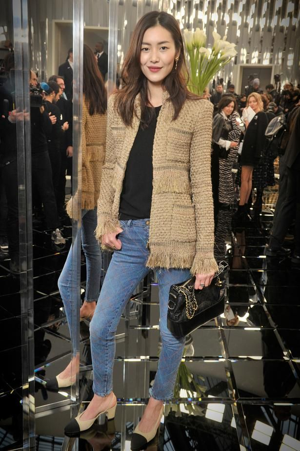 """Victoria's Secret model and face of L'Oreal Liu Wen attends the <a href=""""http://www.viva.co.nz/gallery/fashion/runway-chanel-couture-spring-2017/?ref=gallery"""" target=""""_blank"""">Chanel couture show</a> in Paris, wearing a classic Chanel boucle jacket with fringing detail. Picture / Supplied. <a href=""""http://www.viva.co.nz/gallery/fashion/runway-chanel-couture-spring-2017/?ref=gallery"""" target=""""_blank"""">GALLERY: See highlights from the Chanel show.</a>"""