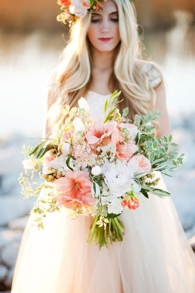 A darling mother - daughter wedding inspiration shoot with a peach, blush, and gold color palette and flower crowns.