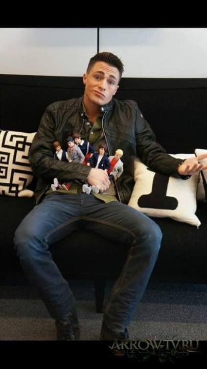 Colton Haynes with One Direction dolls! haha