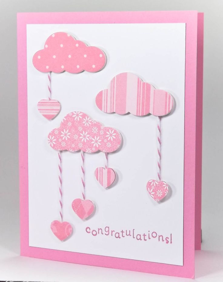 handmade card ... congratulations to new baby girl ... luv the die cut clouds in various designer papers ... cute die cut hearts dangle on pink & white twine ... PINK! ... adorable ...