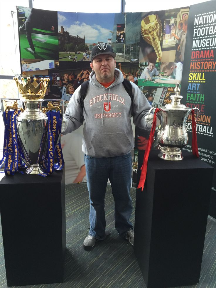 Me with both the FA and English Premiere League Cups at the National Football Museum in Manchester...