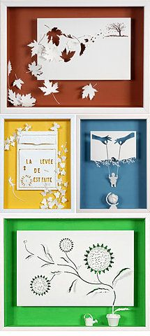 Wall 5 Beautiful paper cuts - the leaves from the tree (top) would be lovely installed above the stationary storage center (opposite current circular seating area)