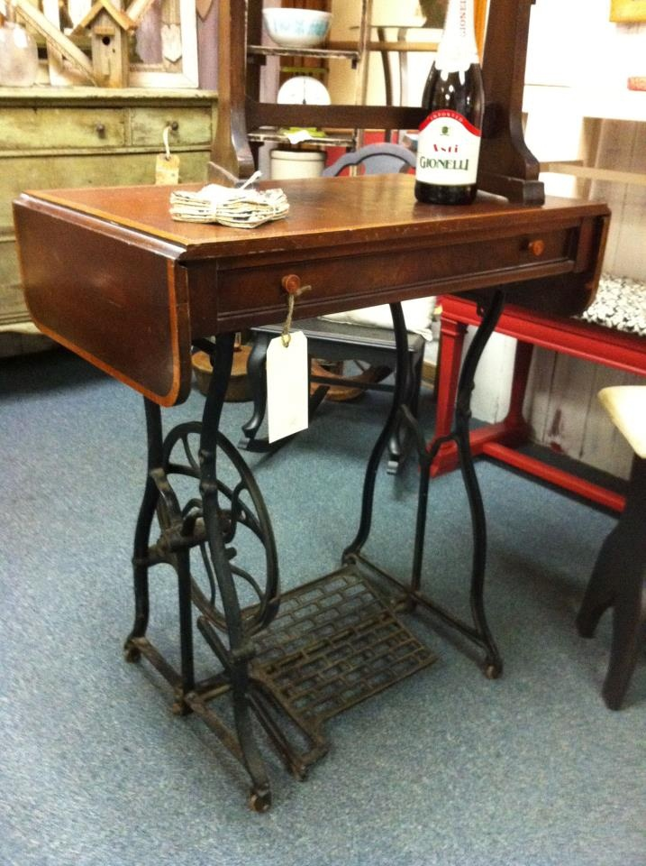 Antique sewing table base with an antique coffee table top.
