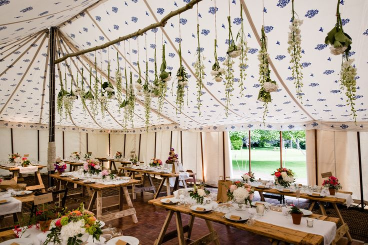 Our 40' x 60' Traditional Canvas Pole Tents with Blue Block roof lining.