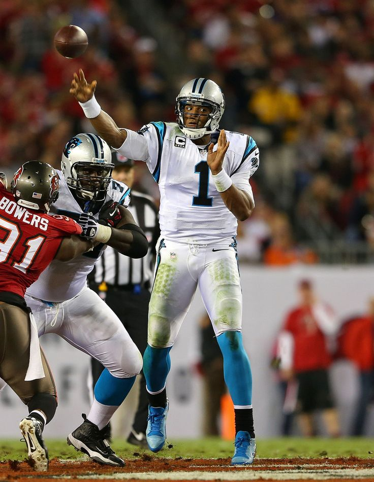 Cam Newton #1 of the Carolina Panthers passes during a game against the Tampa Bay Buccaneers at Raymond James Stadium on October 24, 2013 in Tampa, Florida.