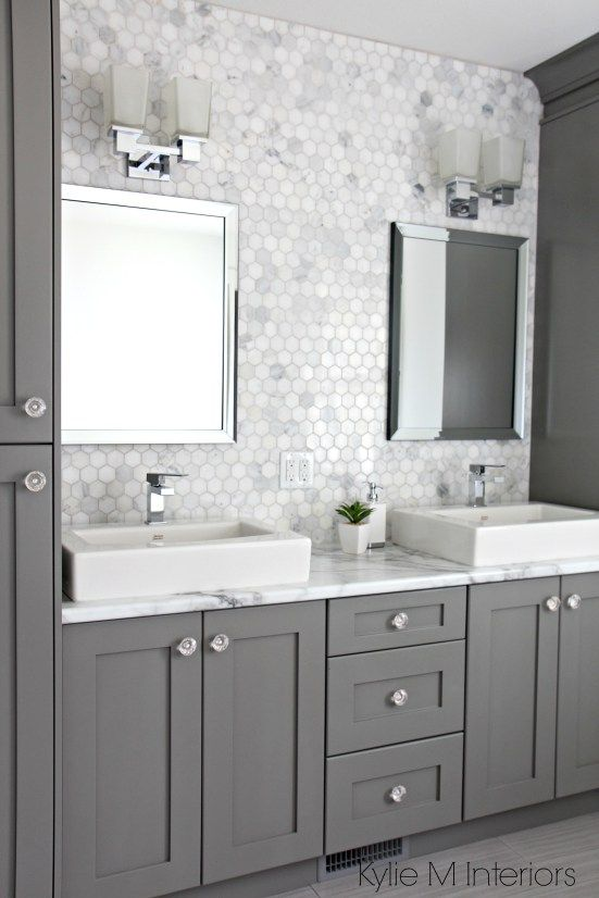 Marble backsplash in hexagon shape with vanity cabinets painted Chelsea Gray, double sinks and chrome accents by Kylie M Interiors