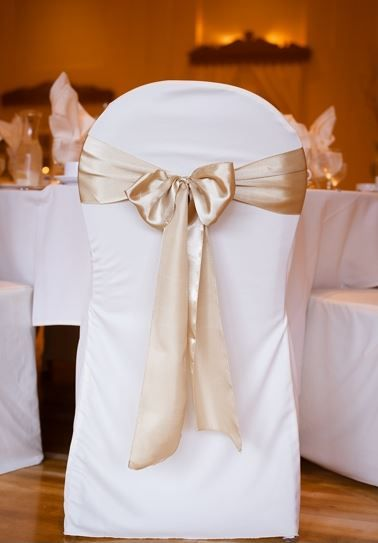 White Scuba Chair Covers and Gold Satin Sashes at the Lafayette Club in Minnetonka, MN   A gold and white Wedding at the Lafayette Club in...