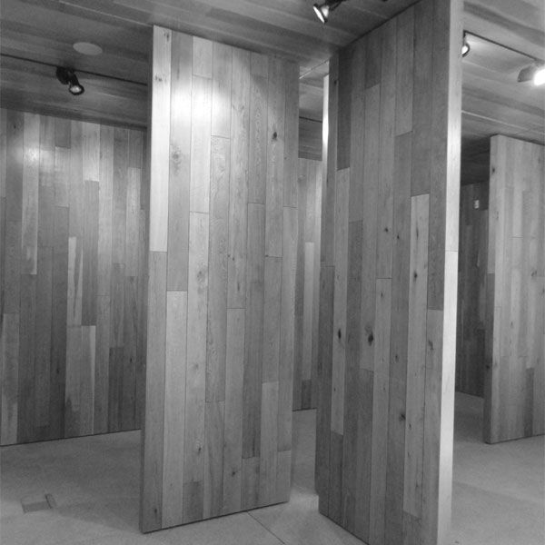 . Rather than traditional partition systems, movable timber clad panels, top hung with multiple tracks allow for an unlimited gallery layout to adapt to the user's needs with discrete flexible hanging systems avoiding the need for sticking or pining.