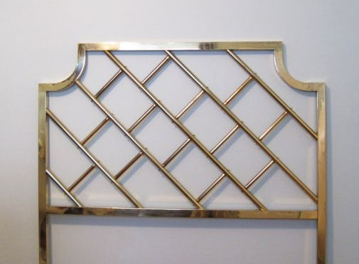 Forget the cheesy faux brass headboards of the '80s.  THIS is a brass headboard!