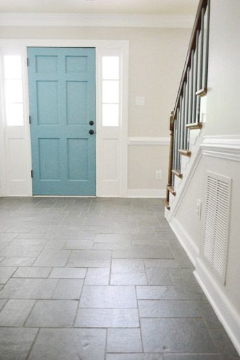 What a bright, cheerful foyer! Door color!!! | Young House Love