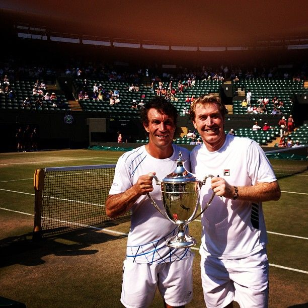 Pat Cash and Mark Woodforde after winning the Wimbledon 45's title for the 4th year in a row.  #tennis #wimbledon #patcash #trophy