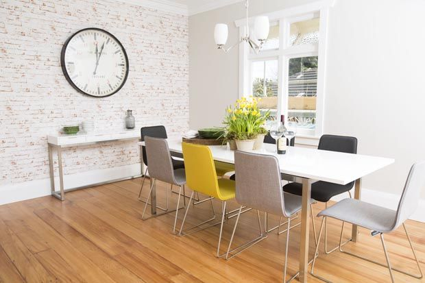 The dining room complete with brick wallpaper and large clock - LOVE THE WALL AND CLOCK BOYS