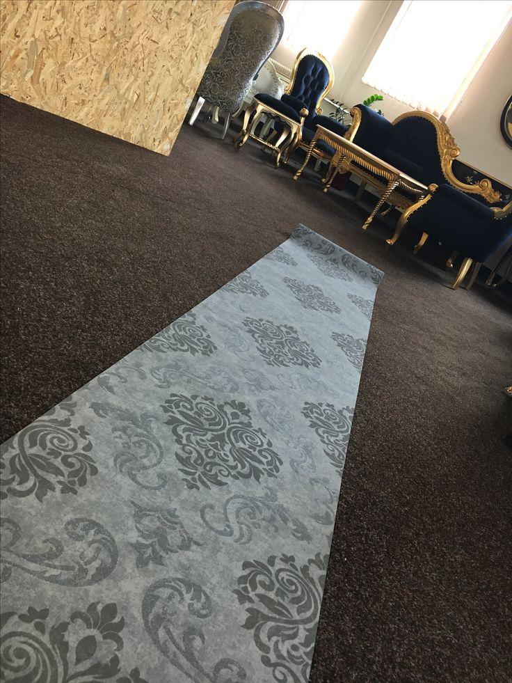 Working on showroom, grey wallpaper