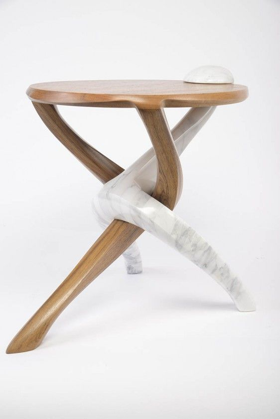 In this teak table, Markus Haase demonstrates his amazing ability to imbue wood and stone with an almost preternatural sense of fluidity and movement. His chairs, tables, and lamps, grow from the ground as if animated waves or columns of smoke.