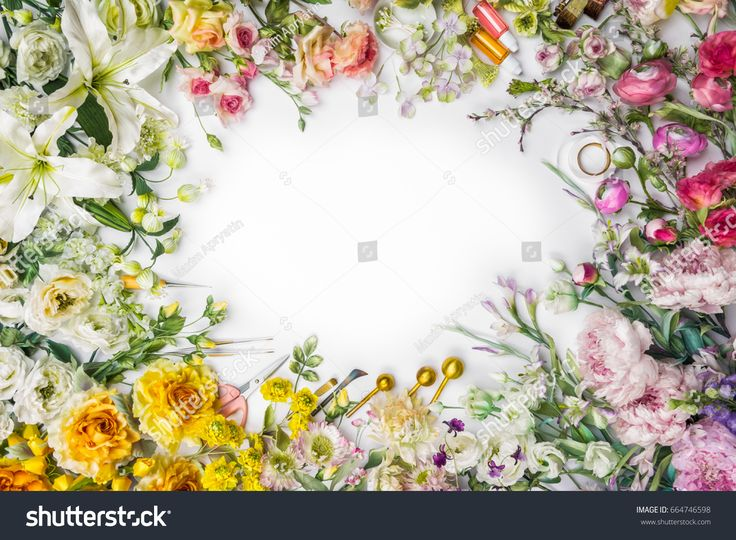 Top view of round frame with decoration artificial flowers, branches, leaves, petals, instruments and paint. isolated on white background.