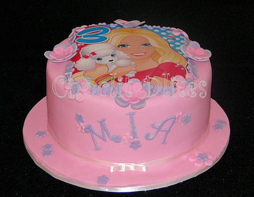 Mia's barbie cake with Barbie edible print and fondant flower detail.