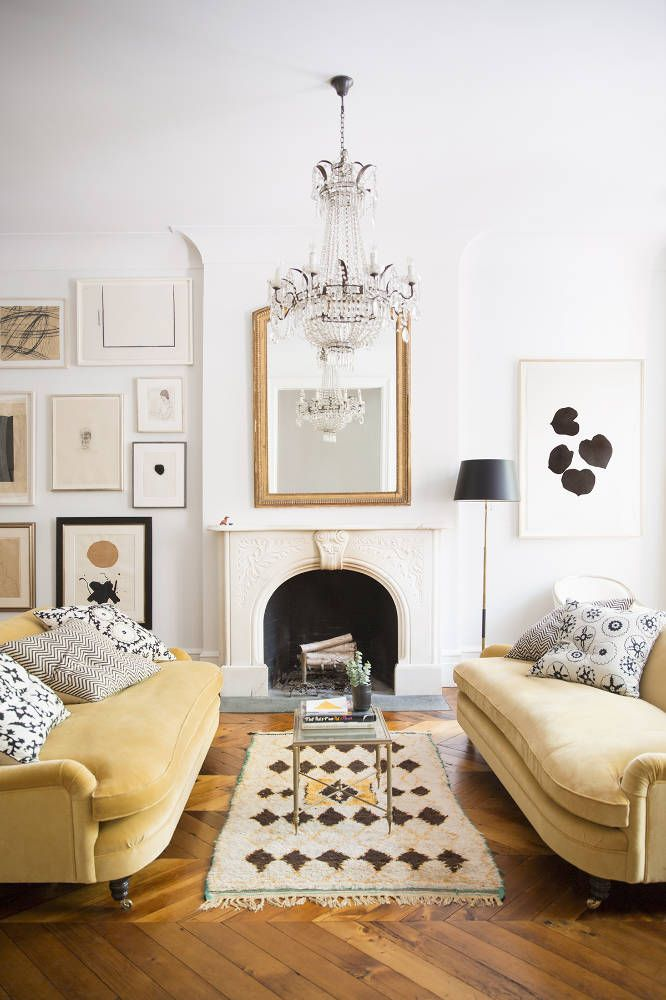 Traditional marble fireplace with gold velvet couches