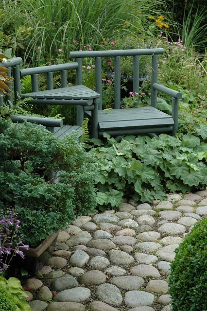 Love the tucked away seating and the big stone path - add a little moss in between and it WOULD be heaven!