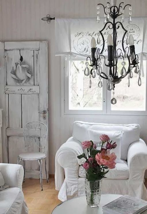 shabby chic style living room with vintage door and chandelier and white chairs and glass flower vase - Shabby Chic Design Ideas