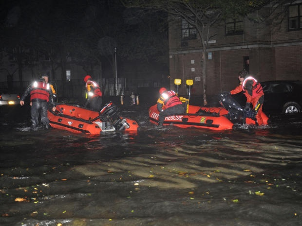 Hurricane Sandy rescue missions    FDNY inflatable boats travel along 14th street towards the East River on a rescue mission in the wake of Hurricane Sandy, Oct. 29, 2012, in New York. Sandy continued on its path Monday, as the storm forced the shutdown of mass transit, schools and financial markets, sending coastal residents fleeing, and threatening a dangerous mix of high winds and soaking rain.    Credit: AP Photo/ Louis Lanzano
