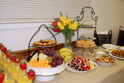 Breakfast buffet---- grapes, pineapple, blueberies, bananas, strawberries, kabobs, cheese cubes.