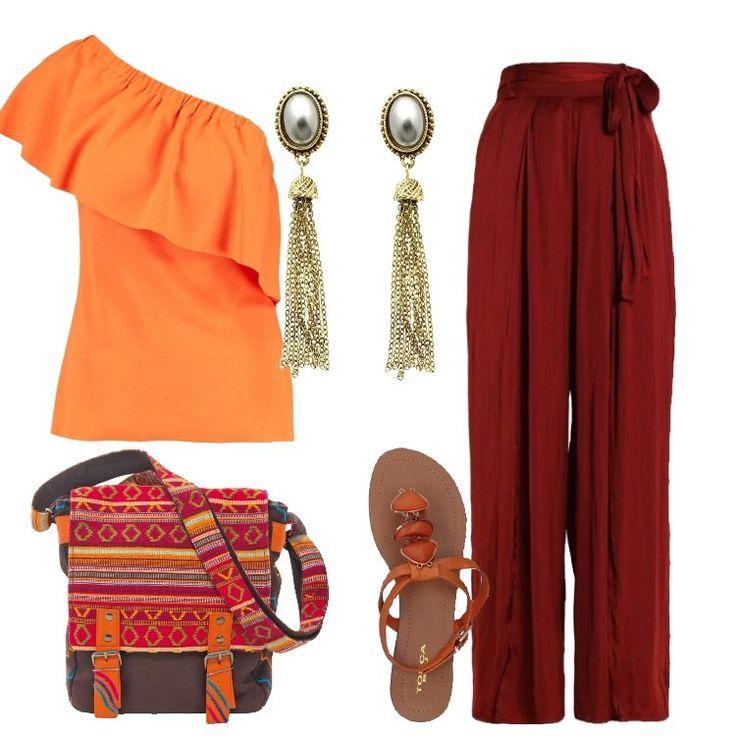 Un outfit originale e pratico, composto da pantalone ruggine, vita alta, a zampa, cintura da annodare, abbinato a top arancione, taglio asimmetrico, volant, spalla scoperta. Sandalo infradito arancione, similpelle, applicazioni a contrasto, borsa a tracolla marrone in fantasia, orecchini in acciaio con perle grigie e frange in metallo.