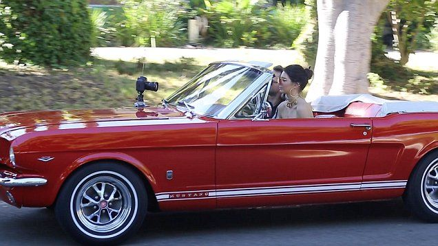 Kendall Jenner takes Derek Blasberg for a ride in her new vintage 69 Mustang convertible. While driving, there was a Canon 5D camera strapped to the hood of the car to film their conversation for KUWTK.