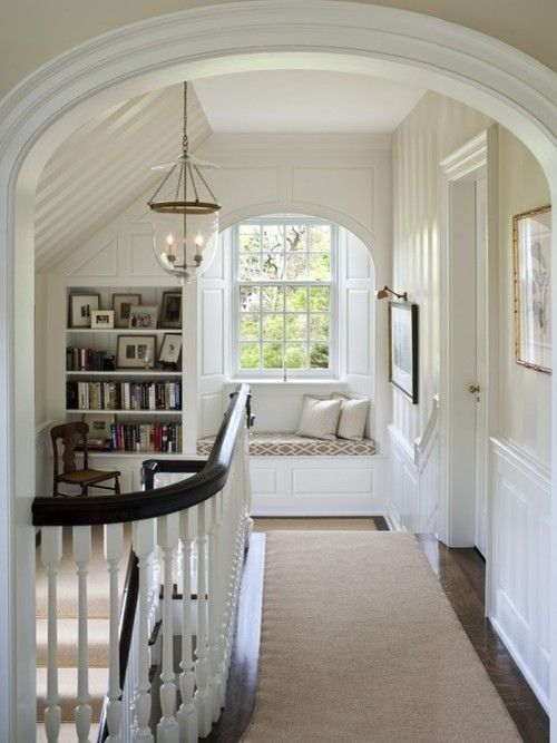 Super cozy window seat and built-in in this lovely stair landing. Adore the millwork, the half vaulted veiling, and the striped effect created by matte and gloss finish paint of the same color.