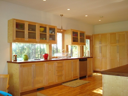 Maple cabinets black granite and under counter window for Window under kitchen cabinets