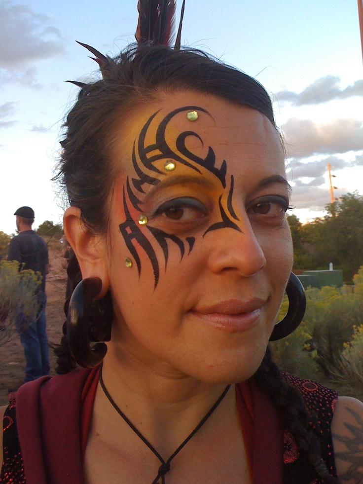 tribal eye face paint design great for festivals like Burning Man and LIghtning in a Bottle.