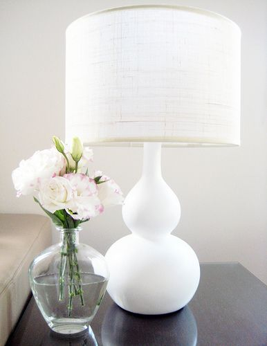 classic, elegant. simple flowers and white lamp