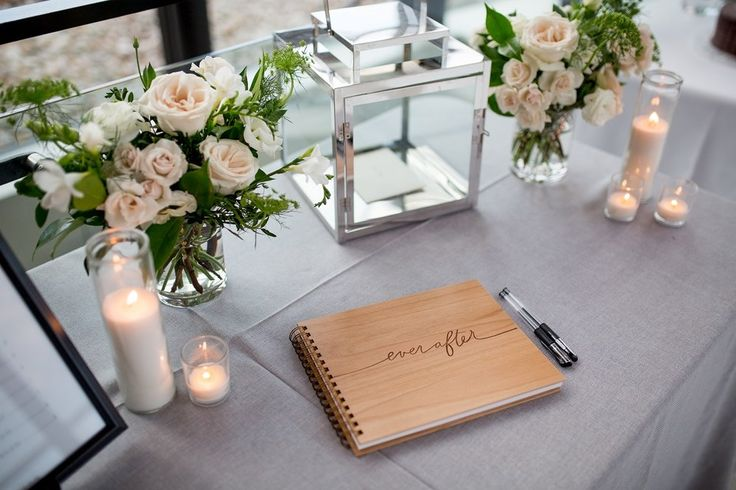 Spencer's At The Waterfront wedding, Burlington ON | Planning & Design by KJ and Co. | grey linen table cloth receiving table, with silver lanter wedding card box, and BHLDN guest book | modern intimate wedding | Photo by Claire Dam Photography