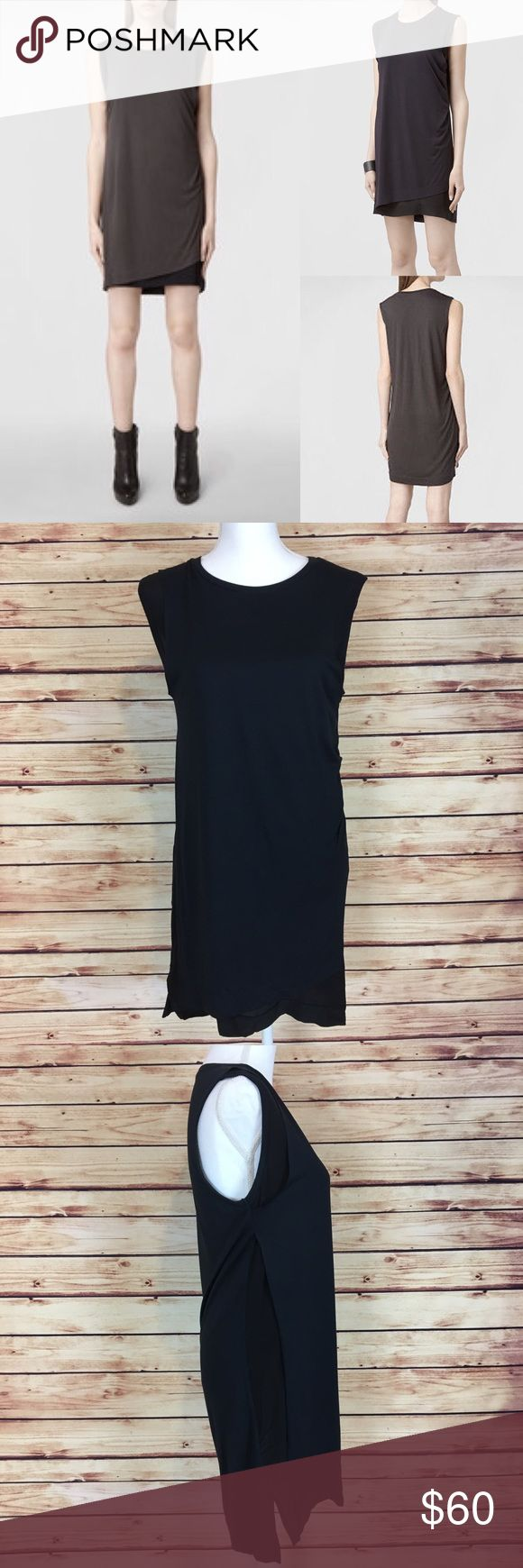 AllSaints Justine Layered Loose Fit Tank Dress AllSaints Justine sleeveless tank dress. Layered: top layer is a dark blue viscose material, almost like a t-shirt material, and the bottom layer is black 100% silk. US size 6. Excellent preowned condition with no flaws. The stock photo shows the charcoal and black version of this dress and is just for styling purposes. The actual dress is dark blue and black. All Saints Dresses