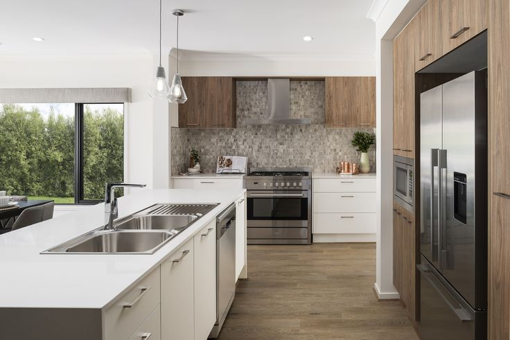 Using a mix of oak and hazelnut timbers will give your kitchen warmth and emphasis the crispness of the fresh white backdrop.