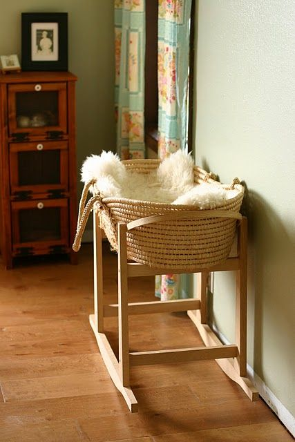 Love the moses basket on the rocking stand with the faux sheepskin blanket!