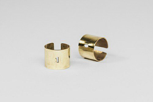The wider rings are carved with numbers 0 and 1, this way we can give our hands a binary code. The size of the rings is adjustable, they are suitable for men and women alike.  #jewelry #design #geometry #maths #minimal #contemporary #serajewellery #brass