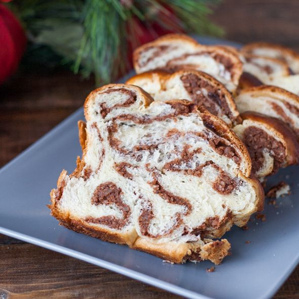 Sweet Walnut Bread known as Cozonac cu Nuca is a traditional Romanian sweet bread made with raisins and walnuts or pecans enjoyed at Christmas and Easter. Click for recipe with lots of step by step photo instructions.