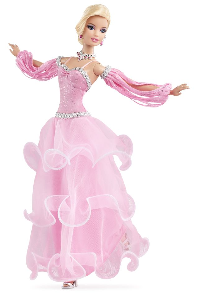Dancing with the Stars Waltz Barbie®, Wearing an elegant, flowing gown, Barbie® is ready to dance the graceful waltz. The shiny pink bodice creates a sparkling effect on the dance floor. The long skirt is layered with three ruffles and silvery trim lines the bodice top, waist and cut-out sleeves. Glittering jewelry matches the gown, which is a light shade of pink.