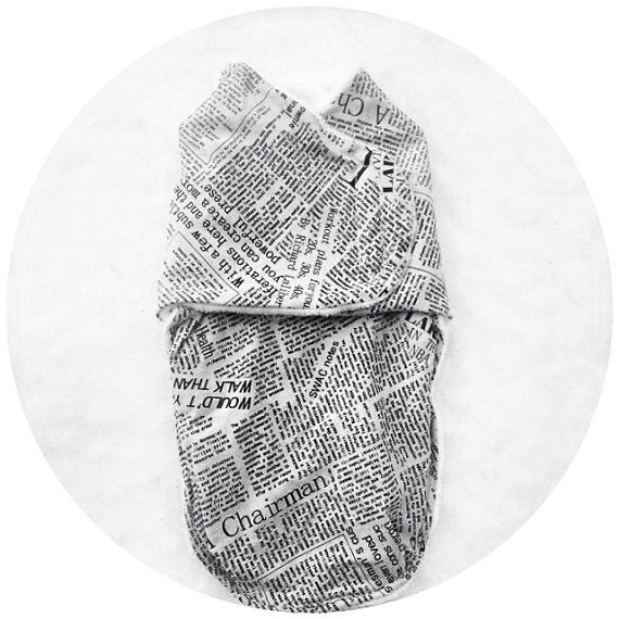 Wrap up your special delivery in this newspaper print swaddle.