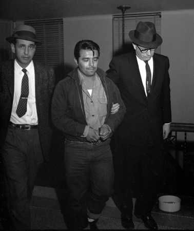 "Perry Edward Smith is led by police officers into the courthouse at Garden City. Smith was arrested in Las Vegas and charged with first-degree murder in the slaying of four members of the Herbert Clutter family at their farmhouse in Holcomb. Fifty years ago, the Clutter murders inspired Truman Capote to write ""In Cold Blood."""
