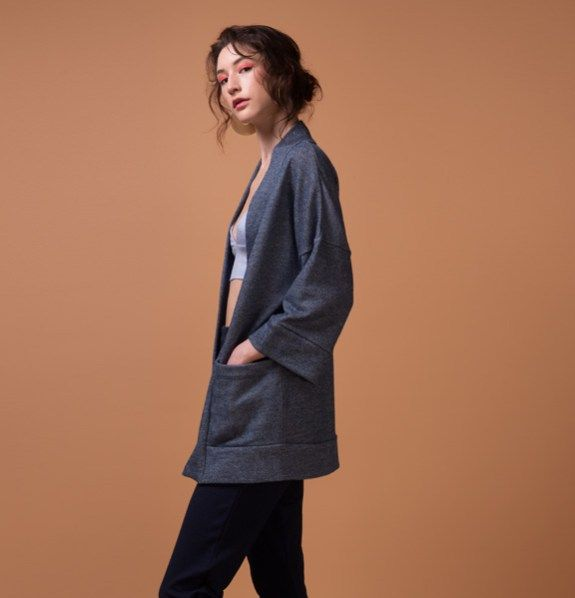 Odeyalo-bloom-kimono-blue-3  Here's another versatile piece that can be worn in a casual or chic way, depending on your mood.  The minimal cut, the soft inside and the oversized pockets are the perfect mix of comfort and functionality.  Wear it over your favorite dress or top.  The lightweight fabric and the denim color will remind you of your favorite denim jacket!    The model is 5'8″/173 cm and is wearing XS/S  54% polyester/46% cotton french terry  Designed and made in Montreal.